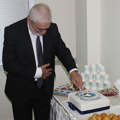 Federation's first meeting. The cake devides one of our honorable members.