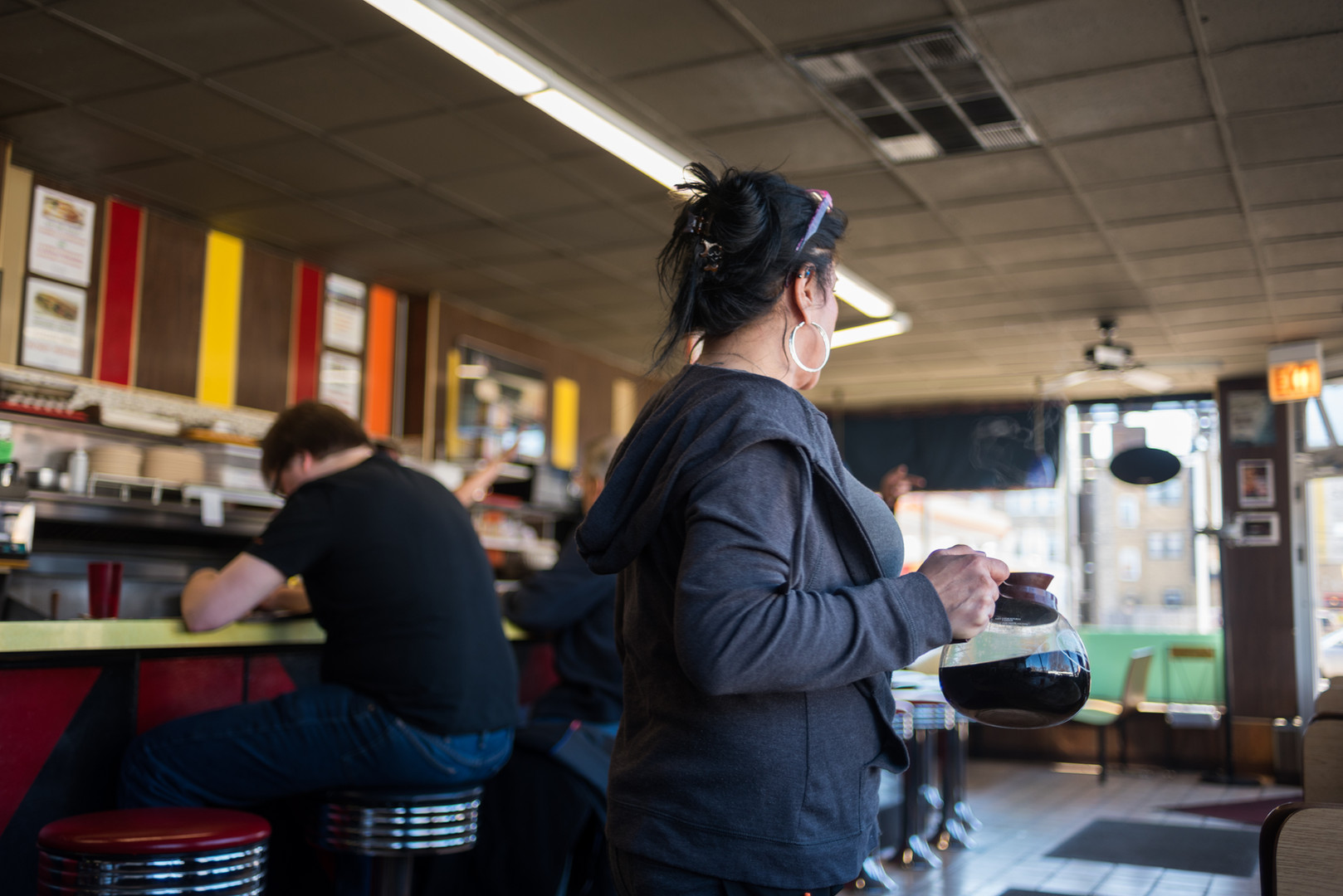 "12:50 p.m. Vickie Lynn Curtis, an employee at Jeri's for 18 years, serves coffee to the afternoon lunch crowd. ""Coffee or anything?"" is a common question asked as customers first enter the restaurant."