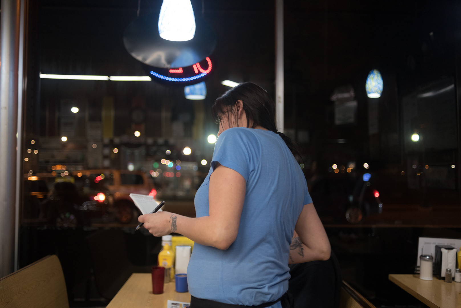6:37 p.m. Candice takes a regular's order.
