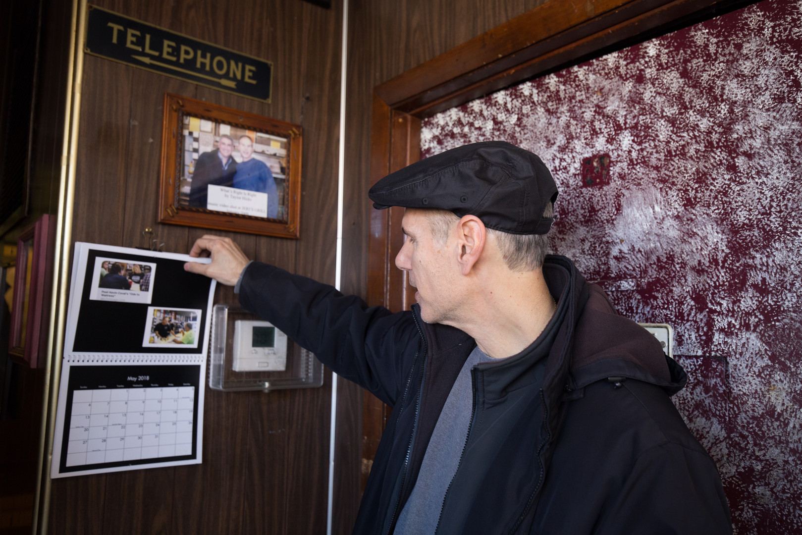 2:01 p.m. Frank flips through the calendar that he makes for Jeri's every year. The calendar includes photos of both the crew and customers.