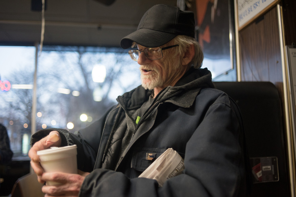 """6:15 a.m. Since he doesn't drink coffee, George relies on Pepsi to keep him caffeinated through the night shift. He pours his sixth can into a styrofoam cup before he leaves. """"Once I get home, I'll switch to poor man's Pepsi: RC,"""" George said."""