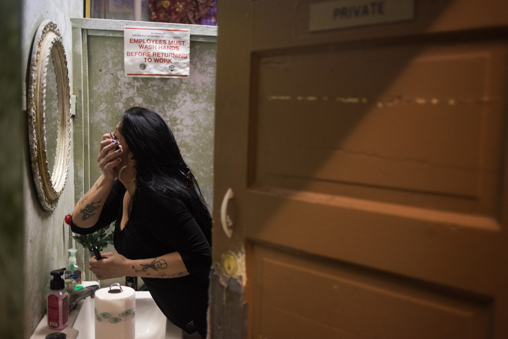 6:11 a.m. Vickie does her makeup in the staff's private bathroom before starting her morning shift with Candice. The two are sister-in-laws.