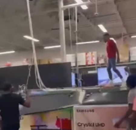 Young boy destroys Smart TVs at a Costco
