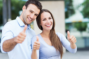 """Happy couple giving """"Thumbs up!"""""""