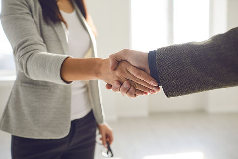 Handshake of businesspeople. Female and male hand makes a handshake in the office