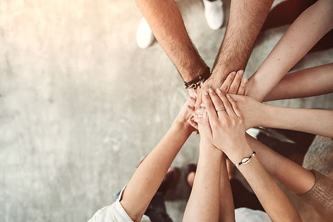 Teamwork, unity concept, group of friends put their hands together