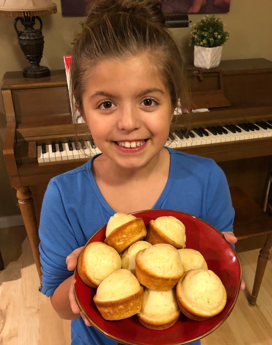 Sofia holding popovers