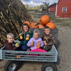 Dana's kids enjoying a fall afternoon at Nelson's Farm Market in Grant, MI.