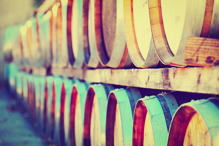 A row of oak wine barrels.