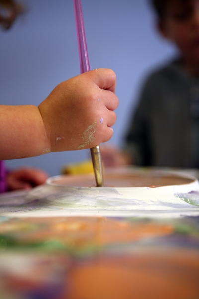 kids hand holding brush
