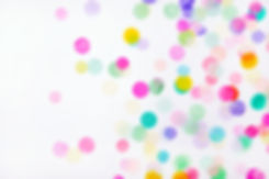 Colorful confetti on white background wi