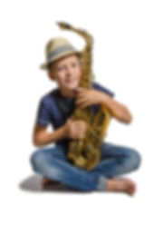 teen sitting with saxophone on white bac