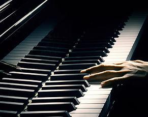 Piano music pianist hand playing. Musica