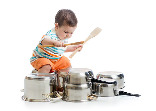 kid boy drumming playing with pots.jpg