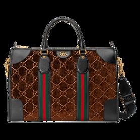 Mittelgroße Reisetasche von Gucci, aus braunem Samt mit charakteristischem GG-Muster und grün-roten Streifen. Preis ca. 1.790 Euro