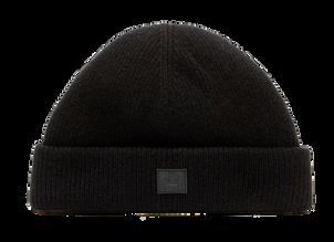 Gerippte Acne Studios Beanie in Schwarz mit eng anliegender Passform, umgeschlagenem Saum und gesticktem Face-Aufnäher vorne. Preis ca. 110 Euro.