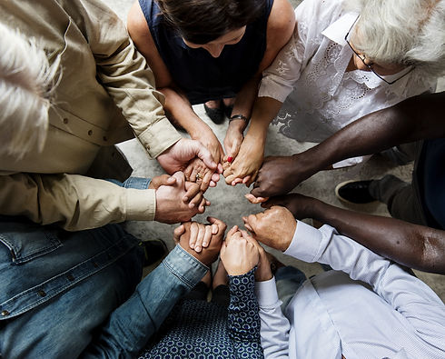 Group of diverse hands holding each othe