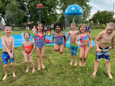 Kids jumping and playing at a water park