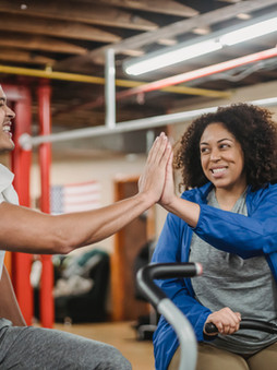 2 people high-5ing after a good workout