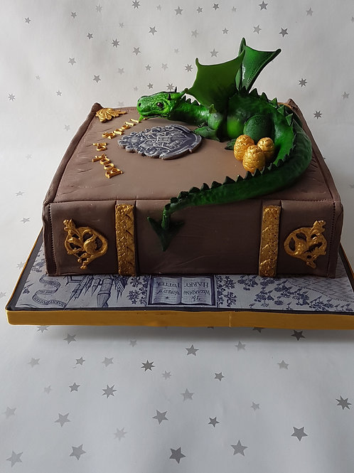 Book and dragon cake