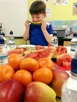 Child enjoying surplus fruit