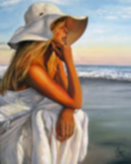 blonde girl looking at the sunset