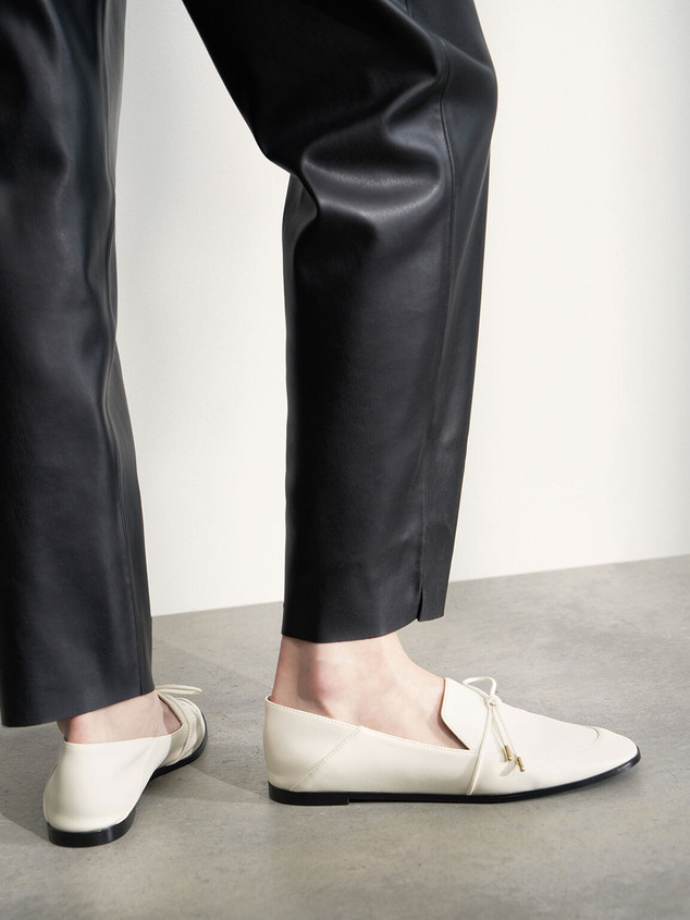 white bow-tie loafers