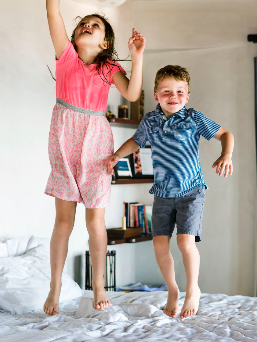 Kids dancing on the bed