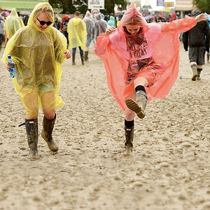 girls in mud ponchos.jpg