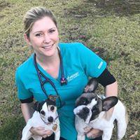 Locum vet Emma poses with her pups