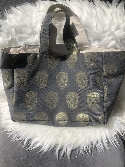 Cabas en toile de coton motifs têtes de mort dorées sur fond gris foncé