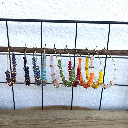 Créoles dorées avec perles à facettes , soleil et perles dorées