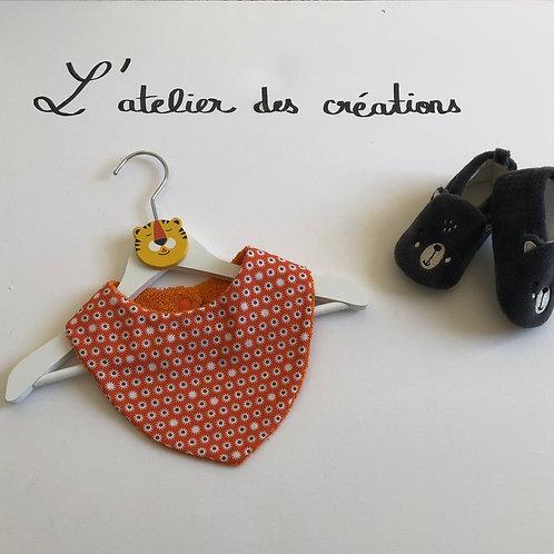Bavoir/bandana en coton et éponge motifs soleils sur fond orange