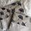 Thumbnail: Trousse pochette en toile de coton aspect lin fleurs gris