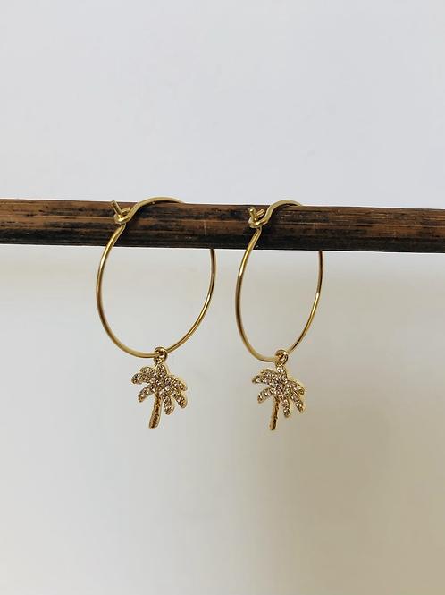 Créoles en métal doré avec breloque palmier doré a lor fin et