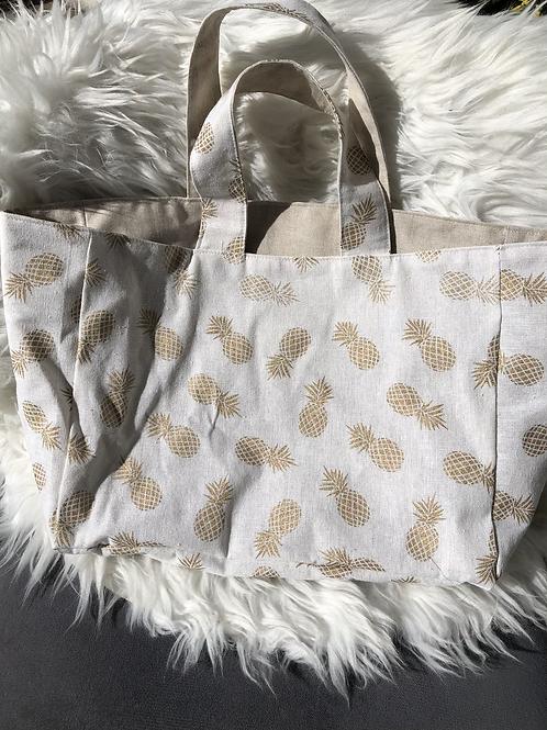 Cabas en toile de jute motifs ananas dorés sur fond blanc cassé