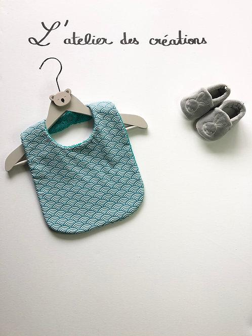 Bavoir en coton et éponge motifs arrondis turquoise et blanc