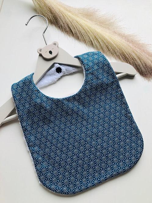 Bavoir en coton et éponge motifs sur fond bleu foncé