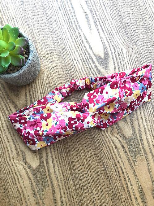 Headband / bandeau en popeline de coton fleuri sur fond bordeaux