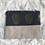 Thumbnail: Trousse pochette en toile de coton grise têtes de mort dorées