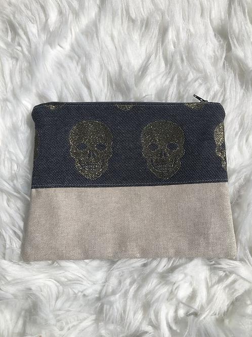 Trousse pochette en toile de coton grise têtes de mort dorées