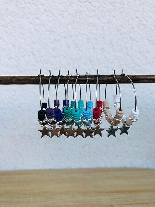 Créoles argentées perles heishi et breloque étoile argenté