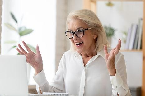 Mature businesswoman sit at desk looks a