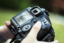 Hand holding dslr camera