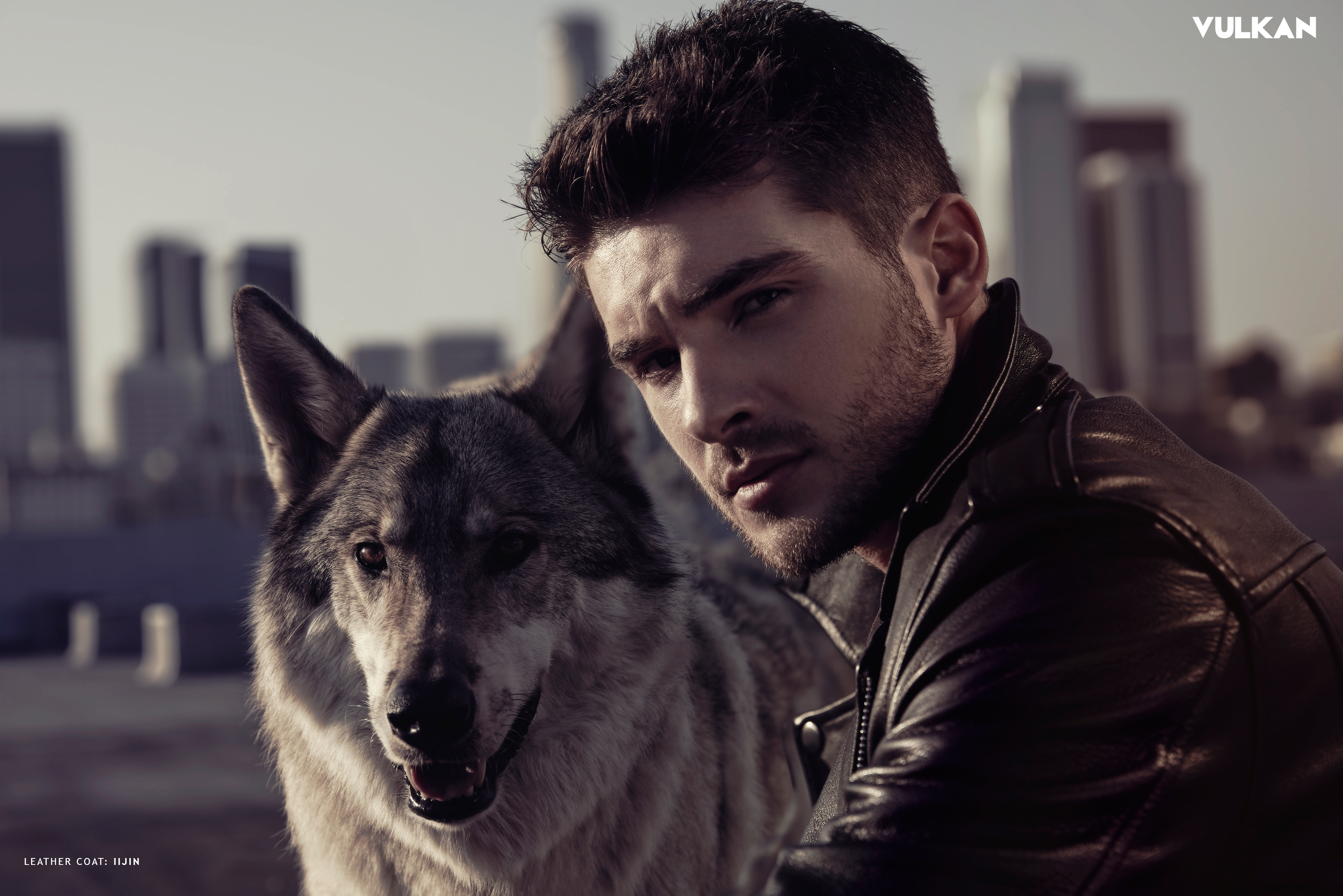 Cody Christian and wolf on a rooftop