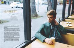 garrett clayton in a suit