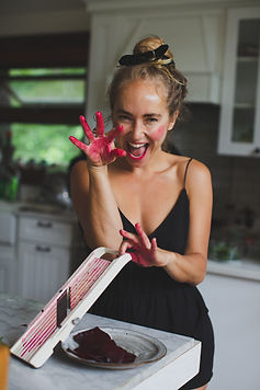 Mikaela playing with beet-colored hands