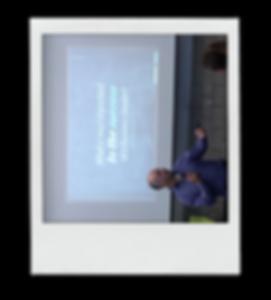 Brad Chase speaking polaroid photo