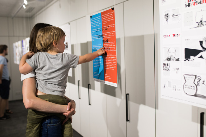Exhibition visitor with a child