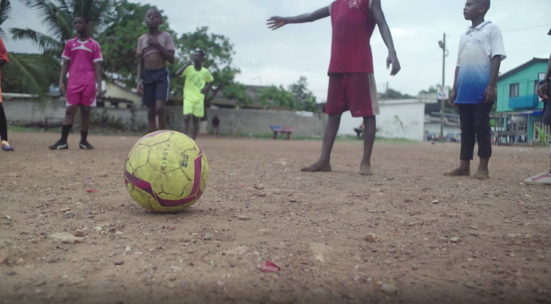 Young black children playing football